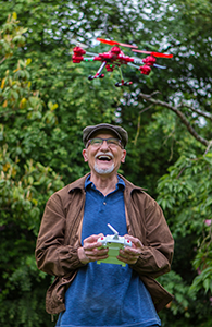 Older man flies a drone in Des Moines WA and reminisces about implant dentistry.