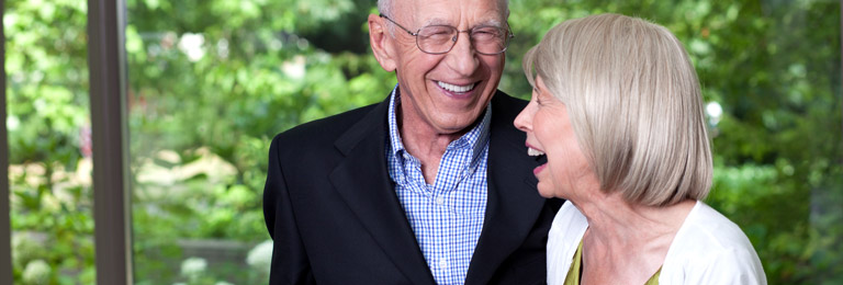 Older couple smiles and shows off their dental implants near Edmonds, Washington.